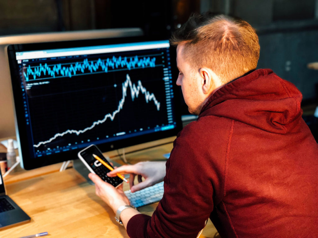 man using Best Investment Tools to maximize phoenix real estate profits