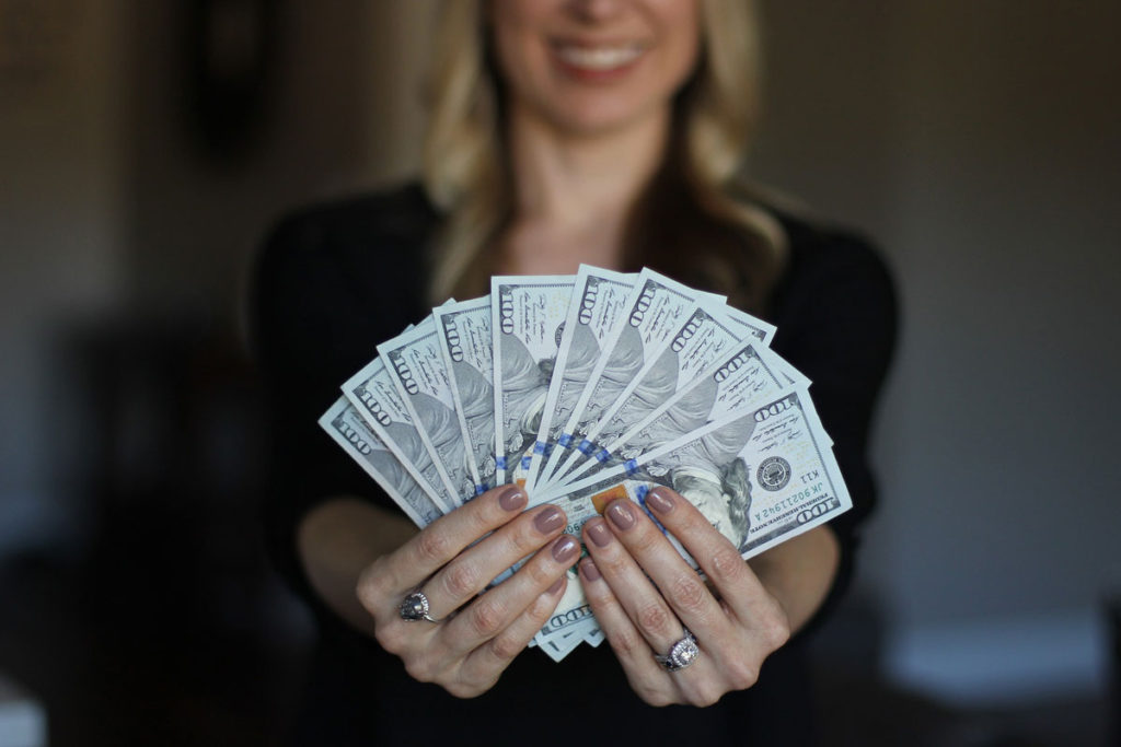 Smiling woman who made good Investments in 2018