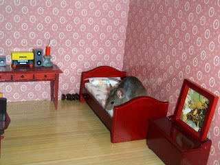 mouse in dollhouse bedroom