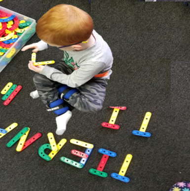 Student demonstrating pattern recognition by using manipulatived to build letters
