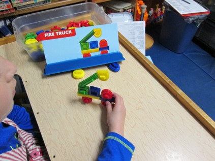 Student building a truck using a task card