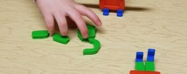 this photo shows a child who is using the Groovy People toy to build a matching figure of a person.