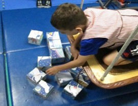 This photo shows  a child working on a block puzzle
