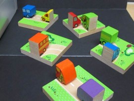 This photo shows  a group of car/truck dominoes