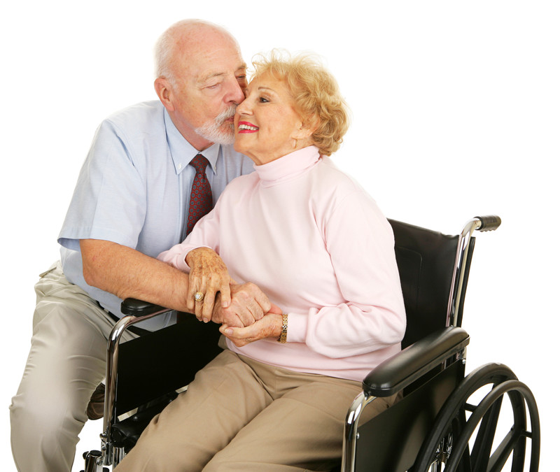 Male caregiver embracing his wife
