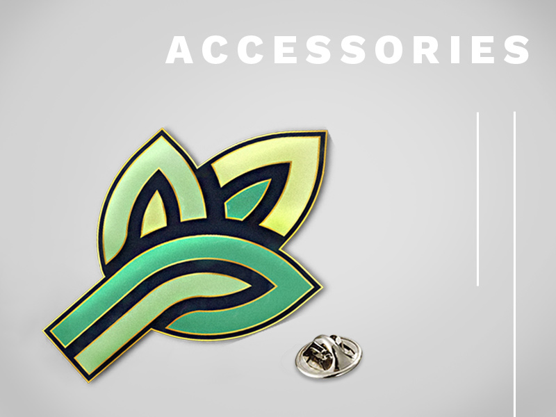 Text: Accessories; Image: Company logo enamel pin with backing.