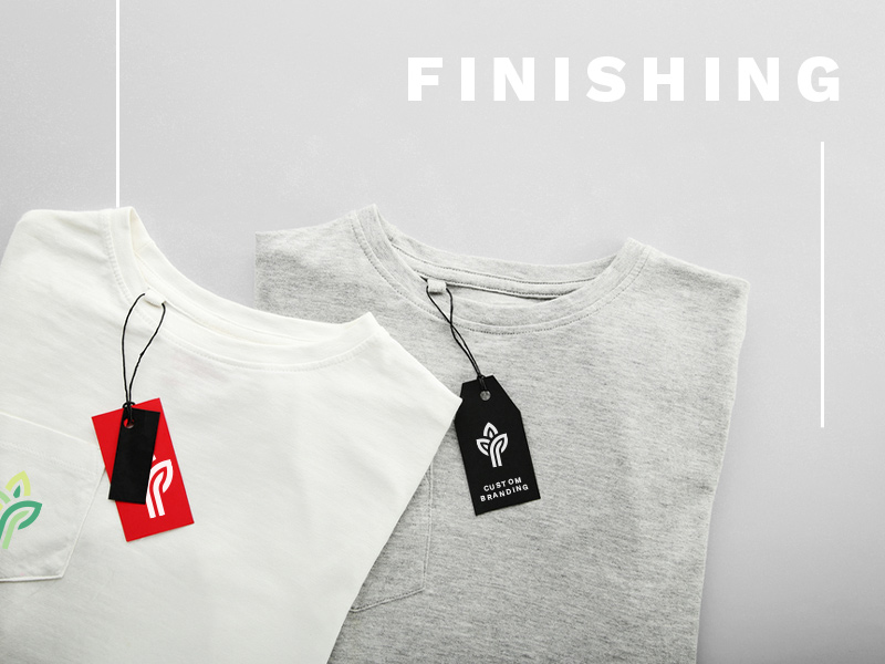 Text: Finishing; Image: Two folded t-shirts with attached hang tags. The hang tags show a company logo.