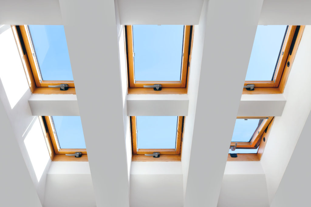 Roof with wall of skylights