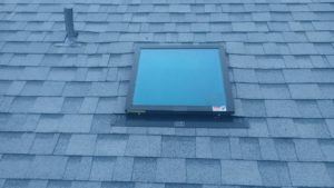 Glass Roof Window on Shingled Roof