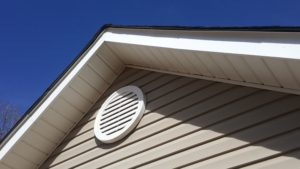 Louvered Gable wall attic vent.