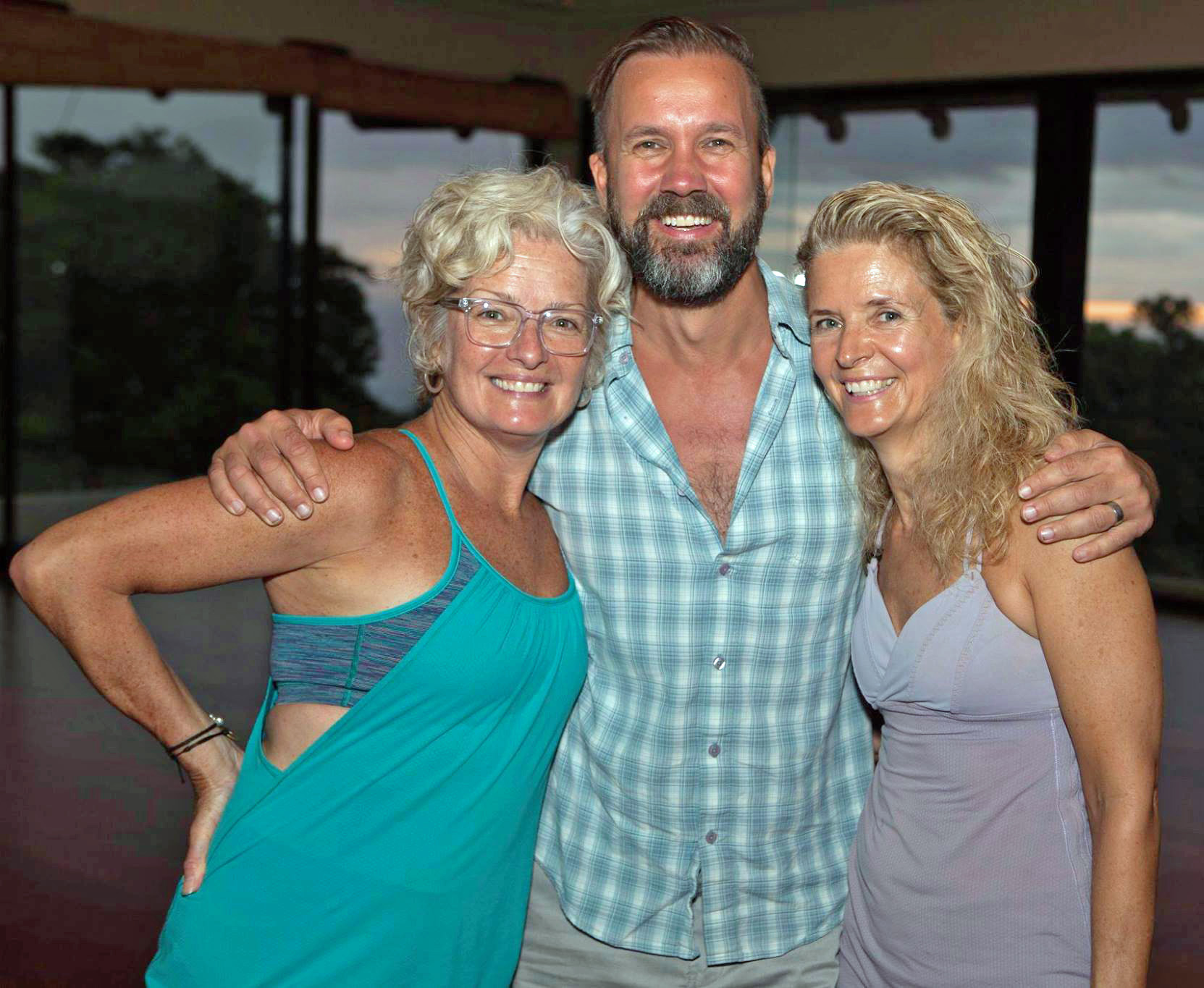 Roxane with her sister Renee and Ted Grand, co-founder Moksha Yoga Int'l