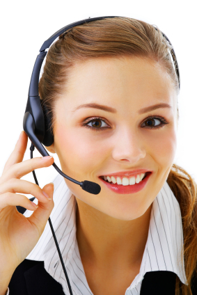 Isolated portrait of a beautiful helpdesk or support line operator answering a call.