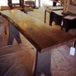 A live edge red oak console table with Eiffel Tower legs
