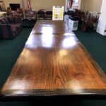 The table is red oak book matched center panels banded with a sycamore live edge.