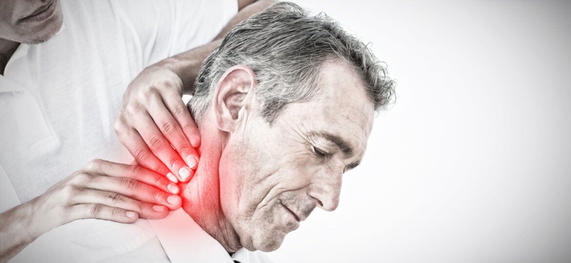 Male chiropractor massaging patients neck against highlighted pain_1600