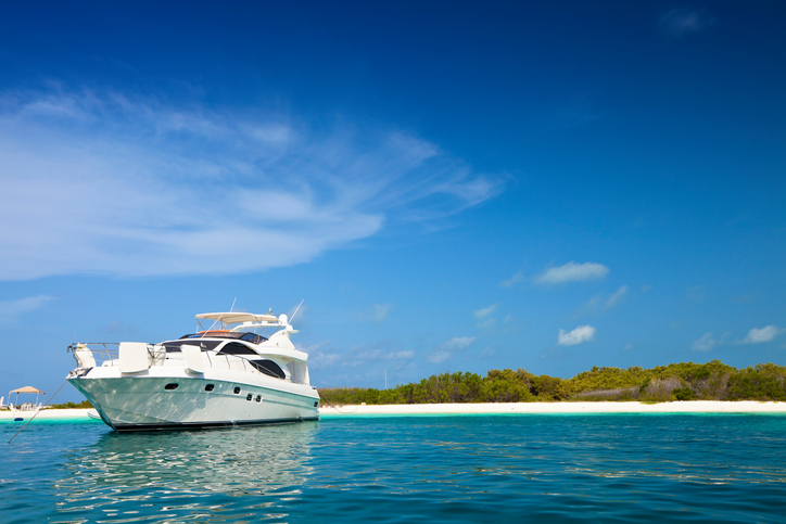 Luxury Yachts anchored in a tropical exotic island beach