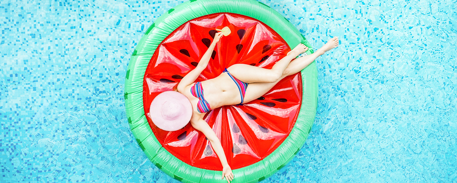 Top view of young woman relaxing on watermelon lilo in villa resort pool - Rich girl floating with fruit mattress drinking cocktail - Summer holiday, luxury lifestyle and fashion concept