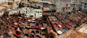 The leather is first dyed in most cases, which is achieved by soaking the leather in big barrels of dye.
