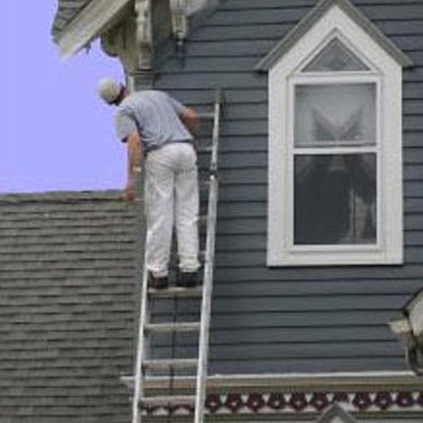exterior painter, blue-gray siding
