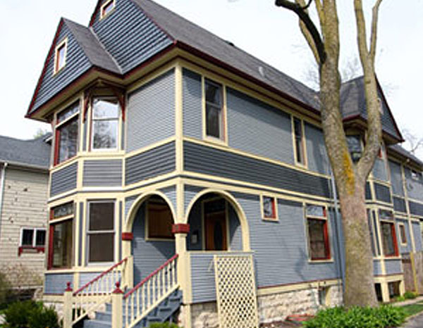 gray house with yellow and red trim, exterior 2