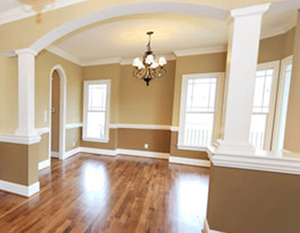 beige and tan room with chandelier and wooden floors