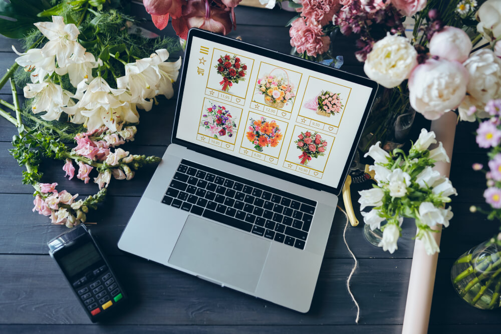 above-view-of-open-laptop-with-flower-shop-website-CMNLAX5
