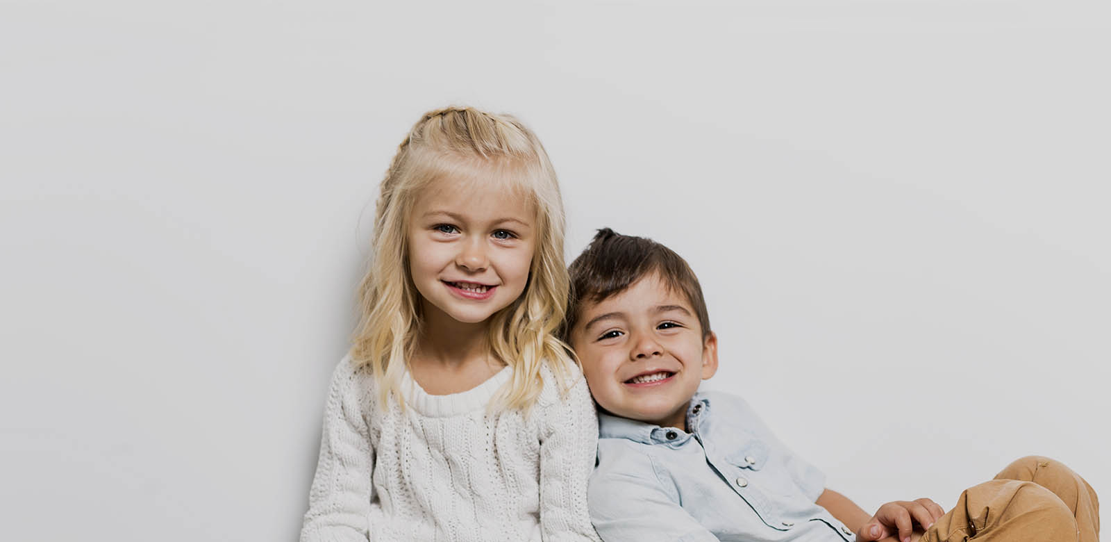 young girl and boy smiling