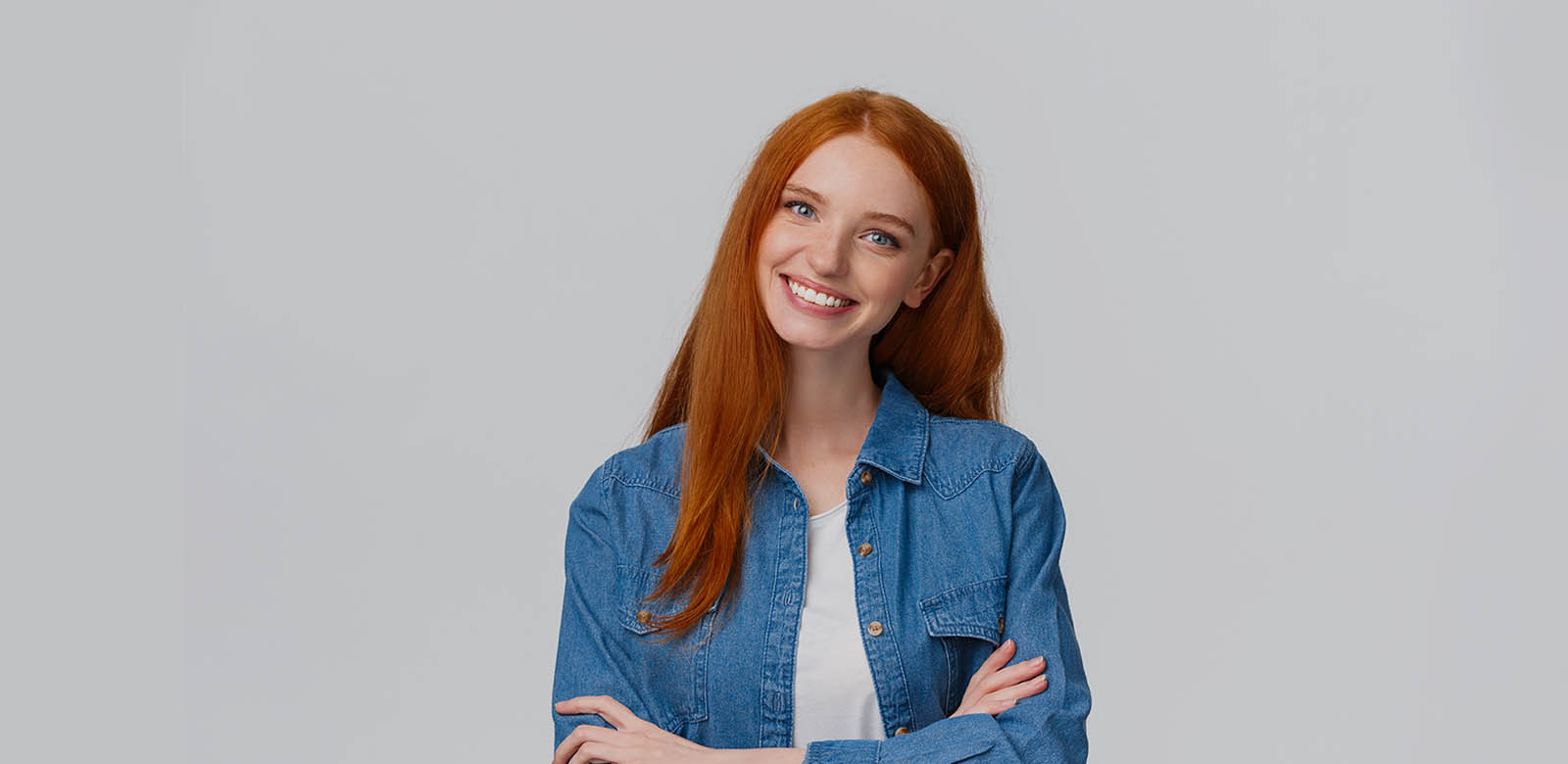 beautiful young woman with orange hair smiling