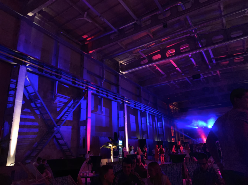 Creative event marketing case study: image of a neon-lit room with stage in distance