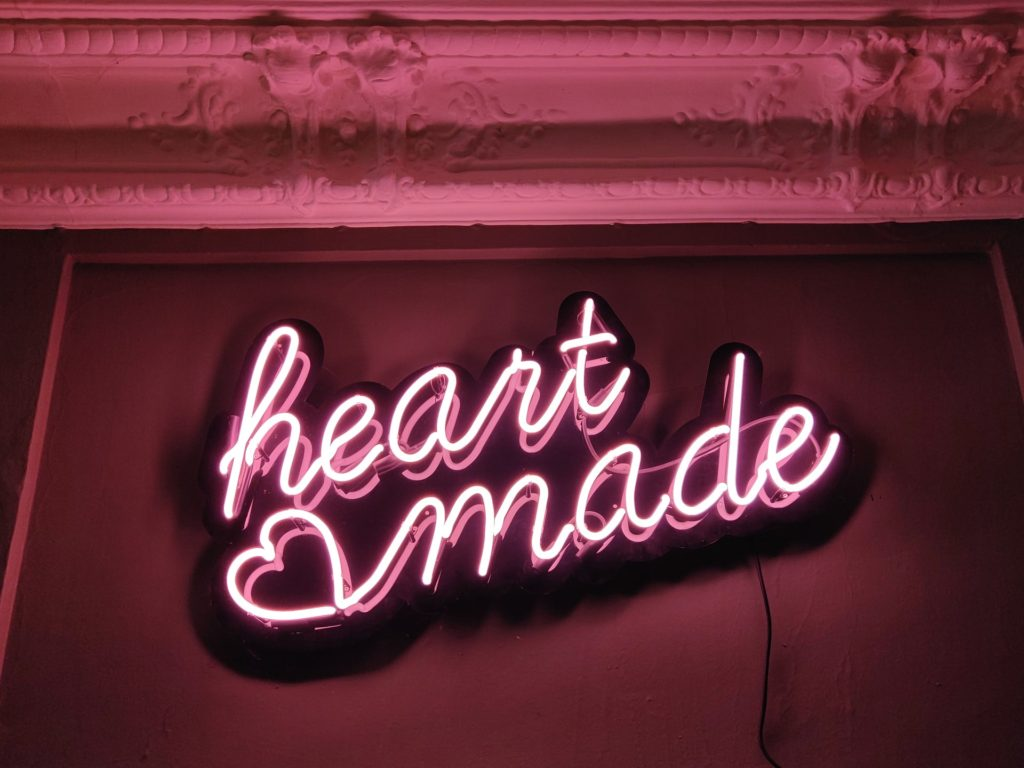 "Neon sign that reads ""heart made"" - because you need relationship and emotional connections to create better case studies and testimonials that are impactful"