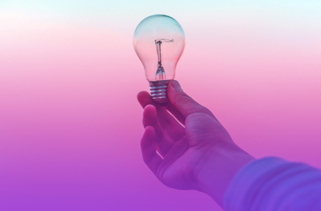 Lightbulb being held by a hand to represent the smart ideas presented in this case study on how COVID-19 inspired a pre launch marketing campaign