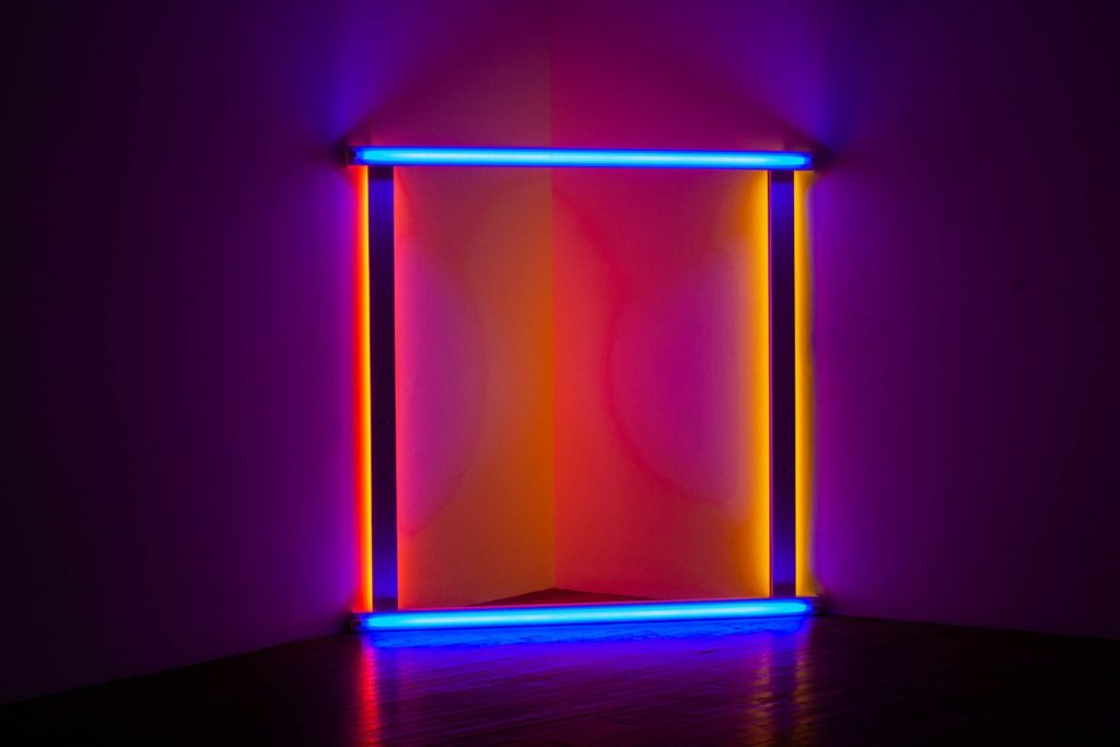 A neon square in blue, orange, pink and purple - develop your freelance marketing strategy to stand out with these tips