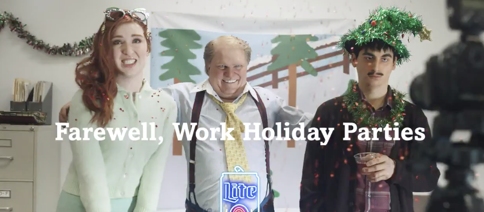3 people smiling awkwardly at a work holiday party with title Farewell, Work Holiday Parties over them written in white text; a still from the Miller-Lite holiday marketing campaigns 2020