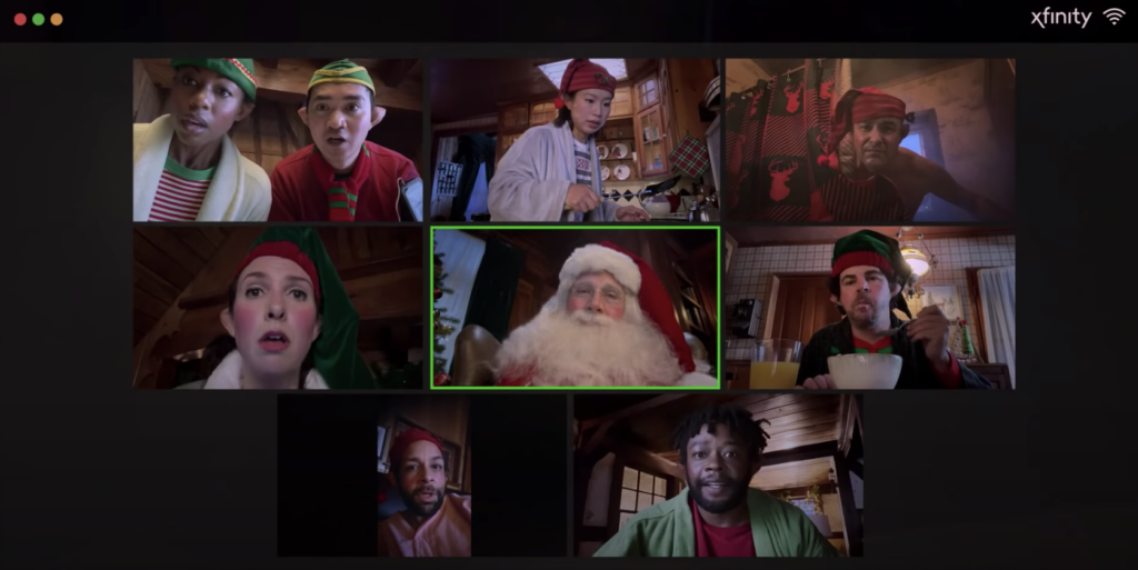 actor steve carell as santa on a zoom call with his elves; a scene from the Xfinity holiday marketing campaign 2020