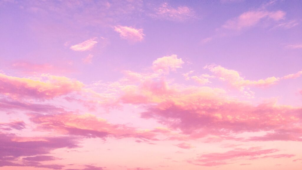 purple colored sky with pink and golden fluffy clouds spotted across it to symbolize the bright opportunities ahead for brands that leverage 2021 social media trends