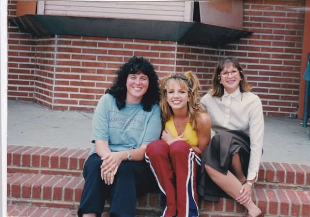 """Kim Kaiman, Britney Spears, and Britney's assistant Felicia on set for the """"…Baby One More Time"""" video shoot in Los Angeles. Kim Kaiman was part of the marketing team that helped shape Britney Spears' brand."""