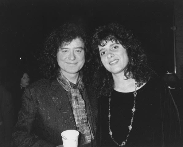 Entertainment marketing executive Kim Kaiman and and Jimmy Page (of Led Zeppelin) smiling for a photo.