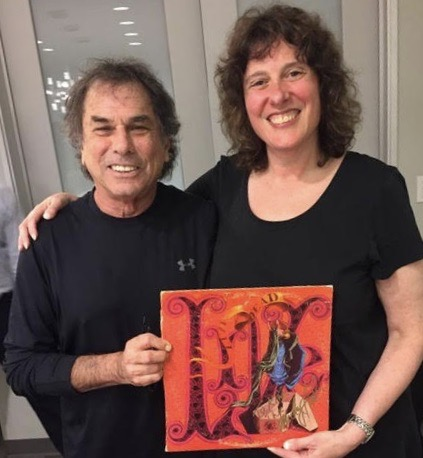 Kim Kaiman backstage with Mickey Hart of the Grateful Dead holding up one of his records