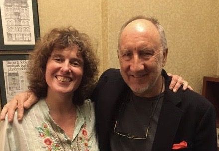 Kim Kaiman posing and smiling with Pete Townshend, co-founder of The Who.