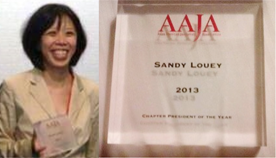 Sandy Louey accepts the chapter president of the year award in 2013.