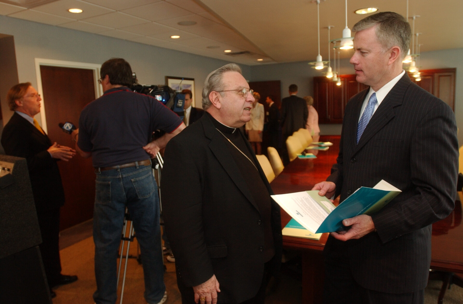 20060504 / STORY / Week in Comm04 / Photo by Patrick McPartland /  As Director of Communications Kevin Keenan advises Bishop Edward U. Kmiec on relating to the media.