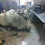 Lovett Pros cutting the concrete at Shari's Restaurant