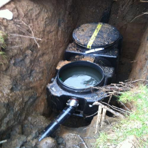 New grease trap being installed by Lovett's Excavation professionals.