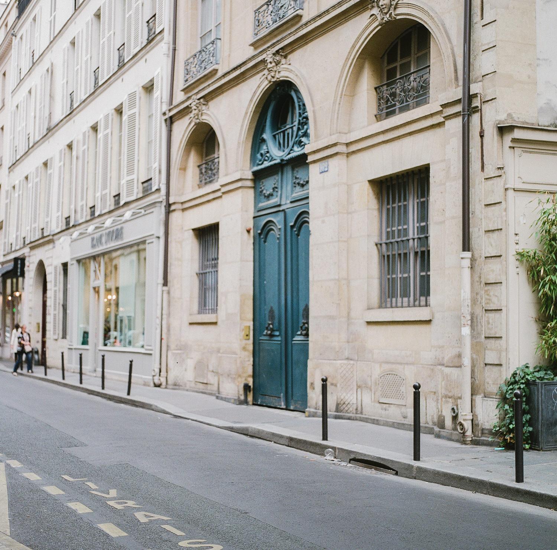 street in Paris France. Teal blue door. Photo by Judith Rae.