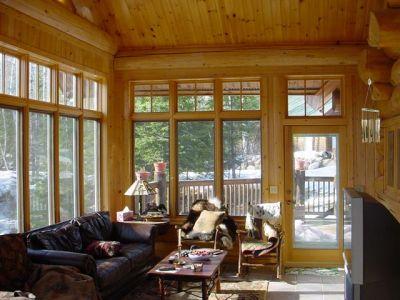 3 season porch in custom scribed cedar log home