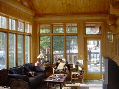 3 season porch in custom scribed cedar log home