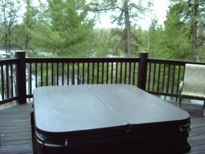 Hot tub on lakeside deck