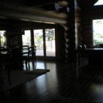 Dark hickory floor, log archway