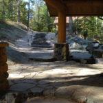 Large log posts, stone landscaping