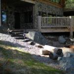 Log home decks, stone foundation